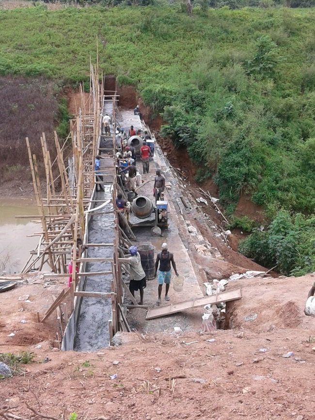 Construction in progress on the Kurudu Small Roller Compacted Concrete (RCC) Dam Project
