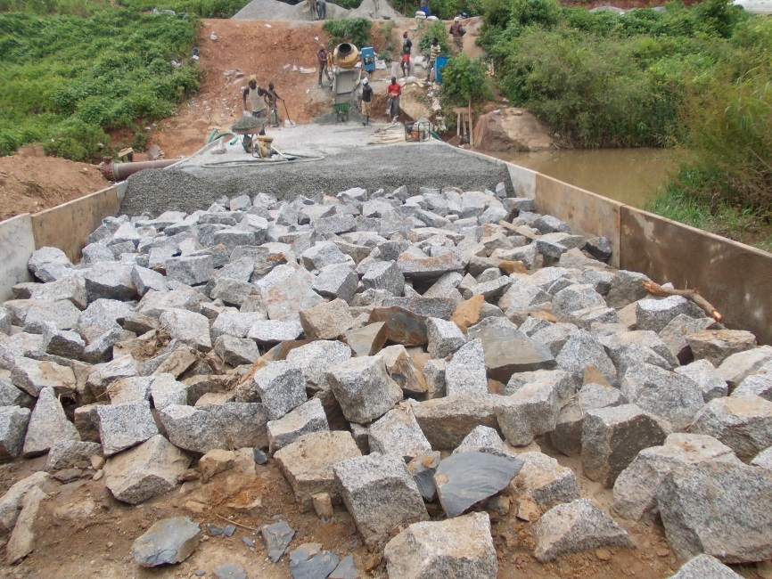 Placement of boulders and concrete on the Kurudu Small Roller Compacted Concrete (RCC) Dam Project